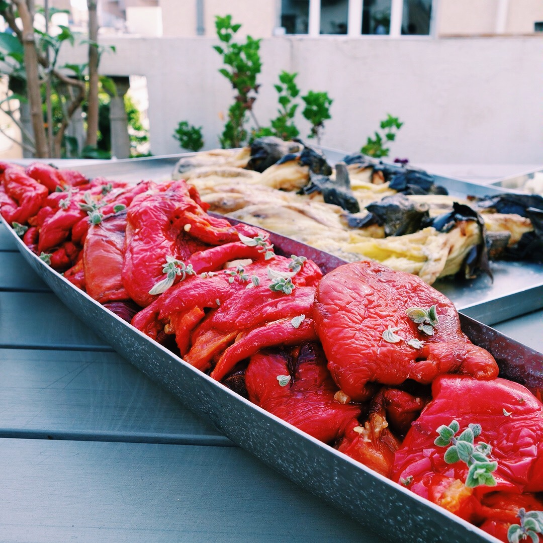 A platter of grilled red peppers