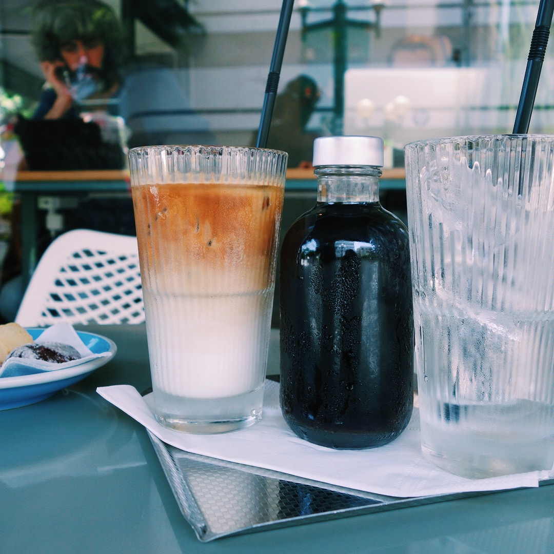 Cold brew in a bottle and an ice latte