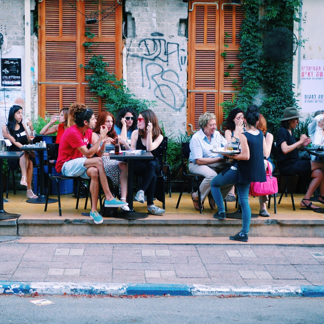 People having drinks at a sidewalk cafe