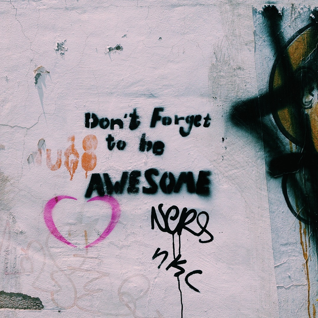 "Graffiti on a wall: ""Don't Forget to be AWESOME"""