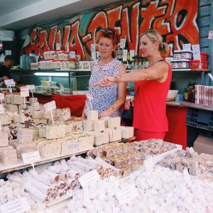 Two women at a halva market stall