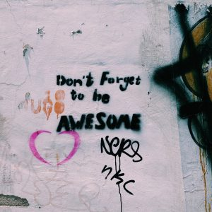 """Graffiti on a wall: """"Don't Forget to be AWESOME"""""""
