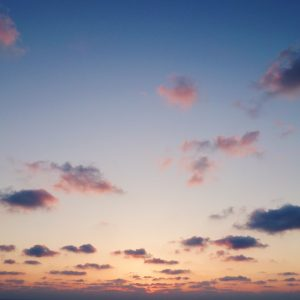 Blue, pink, orange sky with clouds