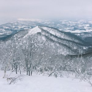 Snow-covered mountains and landscape in Rusutsu's