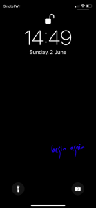 """iPhone screenshot with a black background and the words """"begin again"""" in blue"""